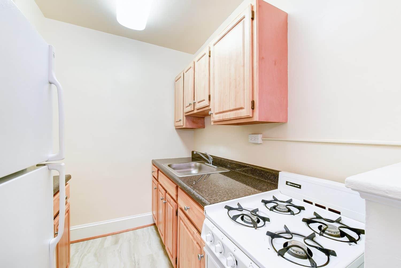https://www.wcsmith.com/wp-content/uploads/2016/01/4031-Davis-Place-Kitchen-Appliances-Washington-DC-Apartment-Rental.jpg